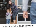 father saying good bye to his... | Shutterstock . vector #1042117525