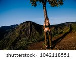 sport girl on the top of the... | Shutterstock . vector #1042118551