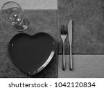 a heart shaped empty plate with ... | Shutterstock . vector #1042120834