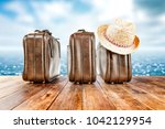 brown old suitcase on wooden... | Shutterstock . vector #1042129954