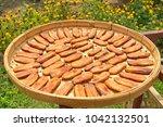 organic thai bananas laid on a...   Shutterstock . vector #1042132501