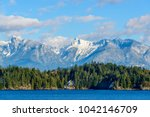 Stock photo fantastic view over ocean snow mountain and rocks at sechelt inlet in vancouver canada 1042146709