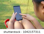 female hand holding the... | Shutterstock . vector #1042157311