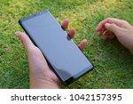 female hand holding the... | Shutterstock . vector #1042157395