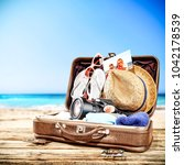 suitcase of brown color and... | Shutterstock . vector #1042178539