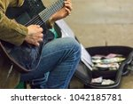 Street Performer Plays Guitar...