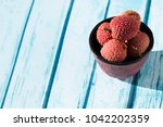 bowl and litchi  | Shutterstock . vector #1042202359