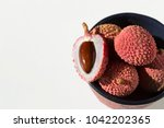 bowl and litchi  | Shutterstock . vector #1042202365