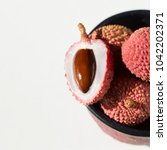 bowl and litchi  | Shutterstock . vector #1042202371