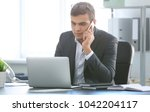 young man in office wear... | Shutterstock . vector #1042204117