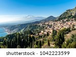 a panoramic view of taormina ... | Shutterstock . vector #1042223599