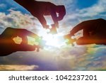 three hands trying to connect a ... | Shutterstock . vector #1042237201