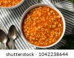 healthy alphabet soup in tomato ... | Shutterstock . vector #1042238644