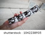 hand holding a photo booth... | Shutterstock . vector #1042238935