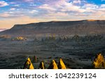 sunrise over the red valley of... | Shutterstock . vector #1042239124