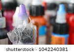 bottle with ink in tattoo salon ... | Shutterstock . vector #1042240381