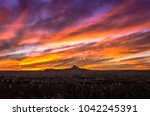 intense sunset over the city of ... | Shutterstock . vector #1042245391