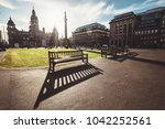 long benches shadows on the...   Shutterstock . vector #1042252561
