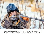 female hunter in camouflage... | Shutterstock . vector #1042267417