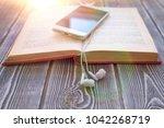 book  smartphone  headphones on ... | Shutterstock . vector #1042268719