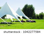 Small photo of Tent awning Star, A white tent or marquee in a green field. star tent, outdoor activities, vents, beautiful awning for relaxation