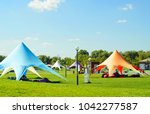 Small photo of Tent awning Star, A white tent or marquee in a green field. star tent, outdoor activities, beautiful awning for relaxation