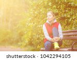 the girl rests on the bench... | Shutterstock . vector #1042294105