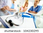 close up of stethoscope and... | Shutterstock . vector #104230295