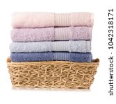 a stack towel in basket on... | Shutterstock . vector #1042318171