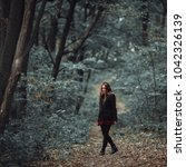 lady walking alone in the forest | Shutterstock . vector #1042326139
