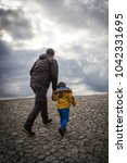 Small photo of Father and child walking