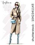 fashion woman in stylish coat.... | Shutterstock .eps vector #1042341145
