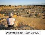 Girl sitting in the Pinnacles desert in Australia - stock photo