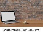 workspace with laptop computer... | Shutterstock . vector #1042360195