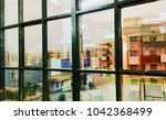 abstract housing building seen... | Shutterstock . vector #1042368499
