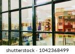 abstract housing building seen... | Shutterstock . vector #1042368499
