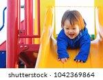mixed race toddler boy playing... | Shutterstock . vector #1042369864