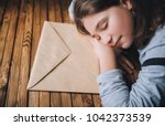 a little girl dreams about what ... | Shutterstock . vector #1042373539