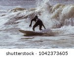 Surfer In A Wetsuit Carving...