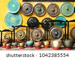 gongs and singing bowls  ... | Shutterstock . vector #1042385554