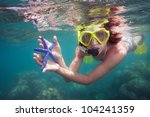 snorkeler holding blue starfish ... | Shutterstock . vector #104241359