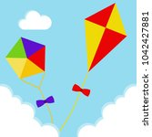 kites fly in the clouds against ... | Shutterstock .eps vector #1042427881