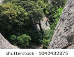 climber climbs to the top ... | Shutterstock . vector #1042432375