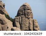 rocks around montserrat... | Shutterstock . vector #1042432639