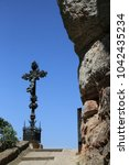 Small photo of Cross with a crucifix in the Montserrat Mountain. Catalonia, Spain.