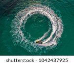 people are playing jet ski at... | Shutterstock . vector #1042437925
