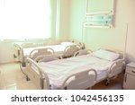 empty hospital or clinical room ... | Shutterstock . vector #1042456135