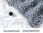 bedding with grey knitted... | Shutterstock . vector #1042464535