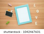 flat lay of photo frame with... | Shutterstock . vector #1042467631