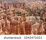 Small photo of Glimpse into the immensity of Bryce Canyon National Park, Utah, taken from the edge of the Rim Trail Cliff. infinite amount of Hoodoos.